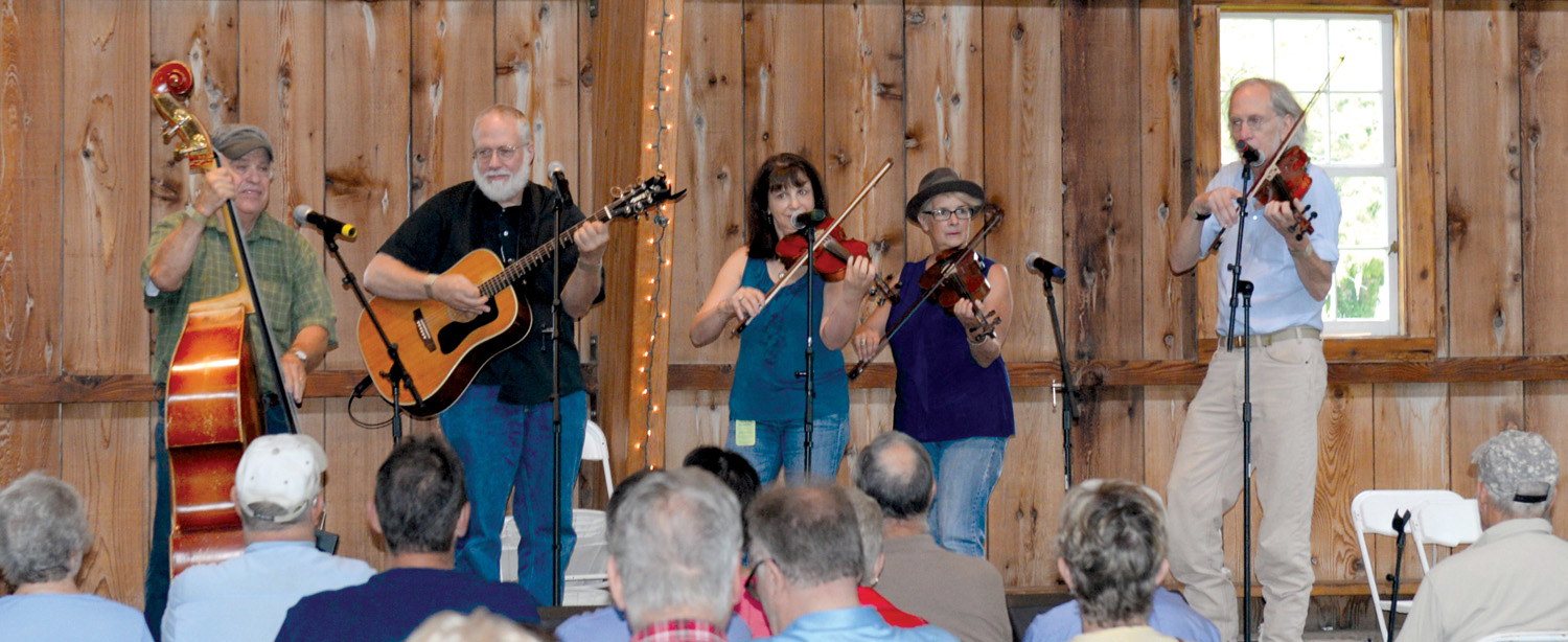 Toe-tapping music fills the hall during Genesee Country Village & Museum's Fiddlers' Fair. Photo by Ruby Foote.