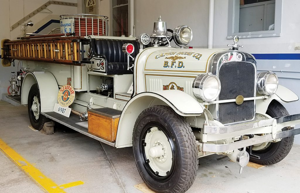 """The headlights of this 1930 Seagrave """"Suburbanite Pumper"""" can be seen peering out at Main Street through the windows of the firehouse garage doors. Called """"The Grey Ghost"""" because of its unique color scheme, the Grey Ghost Exempt Association formed in 1967 and restored it to its present condition. Photo by Dianne Hickerson"""