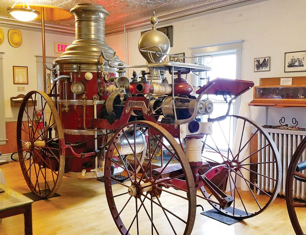 This steam pumper was purchased after a major fire in 1877 destroyed much of the business district on Market Street. There had been little or no fire protection for the growing village. Purchased from Silsby Mfg Co. in Seneca Falls, NY, it was in service until the early 1900s. Improved over the Hand Pumper, it was steam-powered and horse-drawn. Photo by Dianne Hickerson