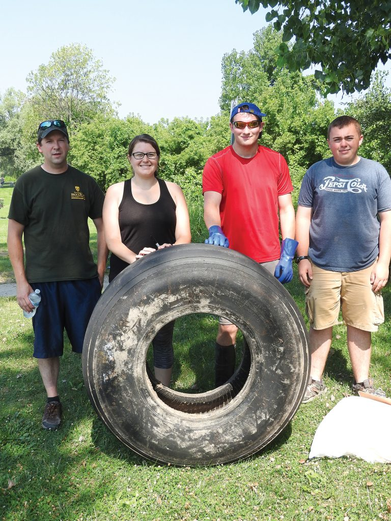 Shown (l-r): Dr. Michael Chislock, Professor Environmental Science & Ecology, Tammy Bleier, Founder Plastic Lakes Project, Alex Henning, Brockport College Student, Dan Beers, Brockport College Student. Photo by Karen Fien