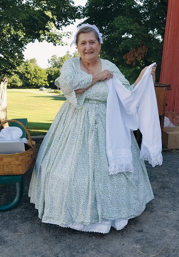 Leanna Hale, Town of Clarkson historian, wears a dress fashioned from the Civil War era. The day was too hot for her to wear her bloomers, she said.