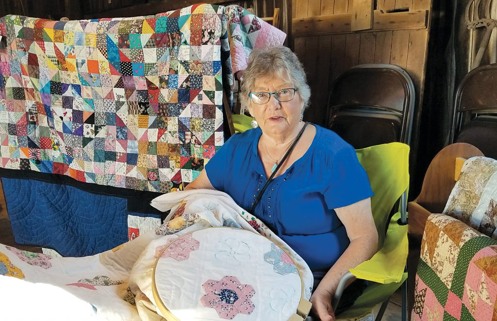 Mary Eunice Weinkauf demonstrated her quilting skills.