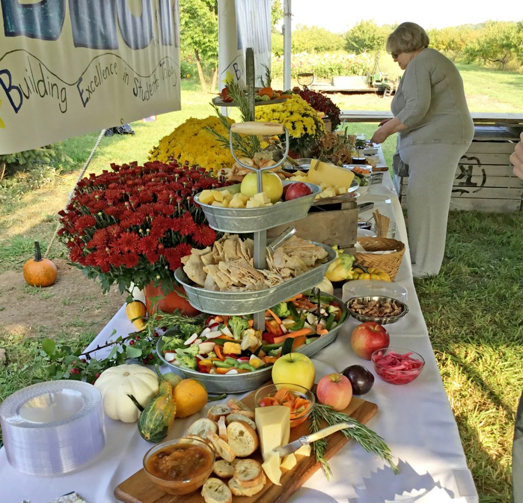 "Last year's ""Farm to Table Fundraiser"" at Kirby Farms had generous offerings from the land seen in the background. Submitted photo"