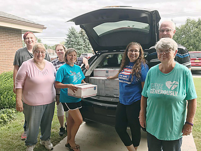 Members of Trinity Emmanuel Lutheran Church in Gates recently collected and packed 41 boxes of donated items going to Puerto Rico. (L-R) Dottie Stoss, Joyce Jelfo and grandson, Shane, Kathy Durfee, Maria Delgado Sutton, Rev. Paul Shoop, Cheryl Crane. Not pictured: Joan Shoop.