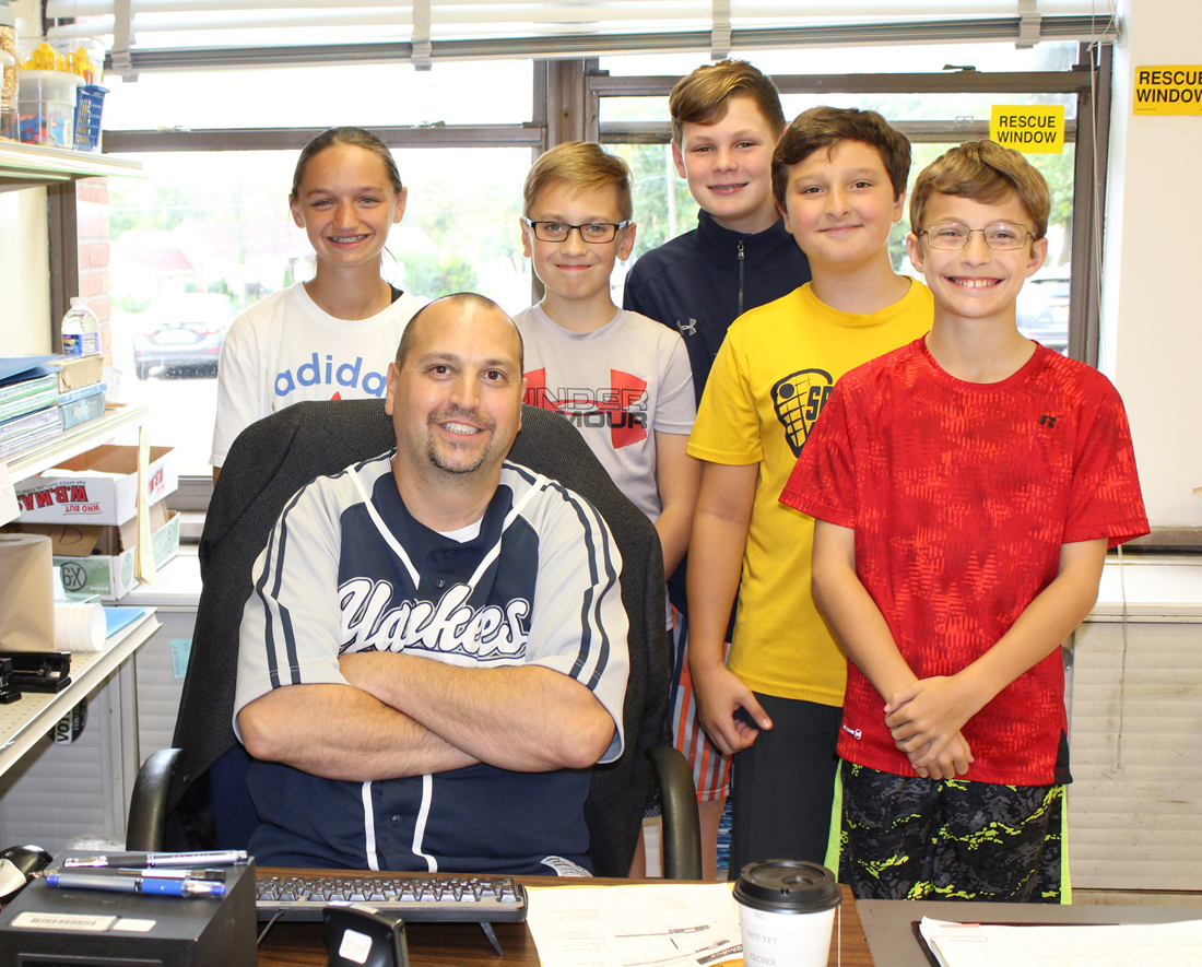 Spencerport math teacher, Matthew Amoroso with eighth grade students, left to right, Torri Fazio, Nicholas Rosipayla, Luke McNamara, Sammy Scoppo and Matthew Lindsey. Provided photo