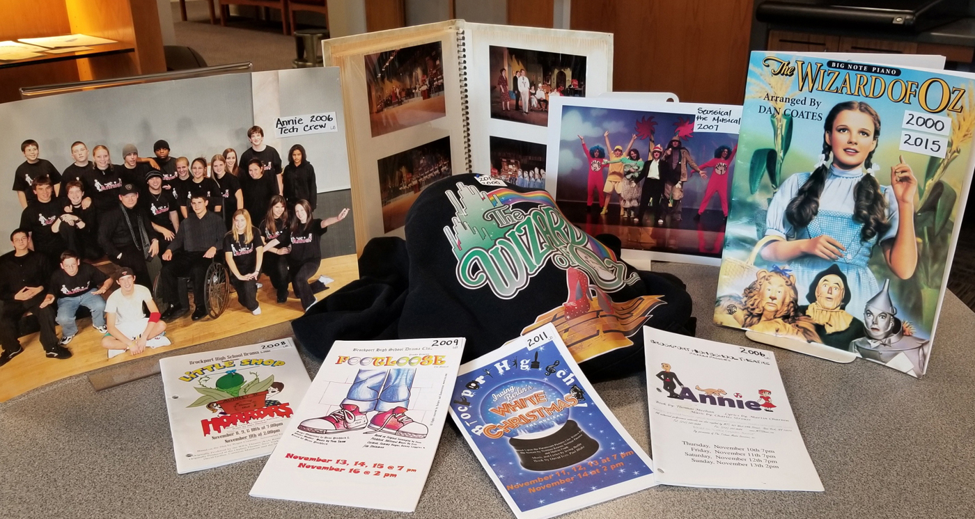 Removed temporarily from their display cases in Seymour Library, this is a sample of objects used to promote various Brockport High School musicals from the past. The vast exhibit in the Local History Room continues through November. Photo by Dianne Hickerson