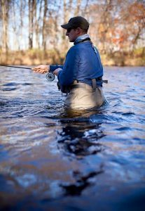 Fly fishing in the Salmon River. Photo by Grant Taylor Photography