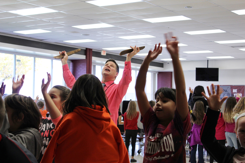 Lawrence Tallman teaches students Native American songs and dances.