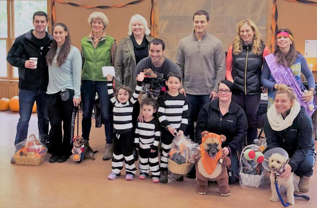 Costume contest winners with their humans and the judges. Provided photo