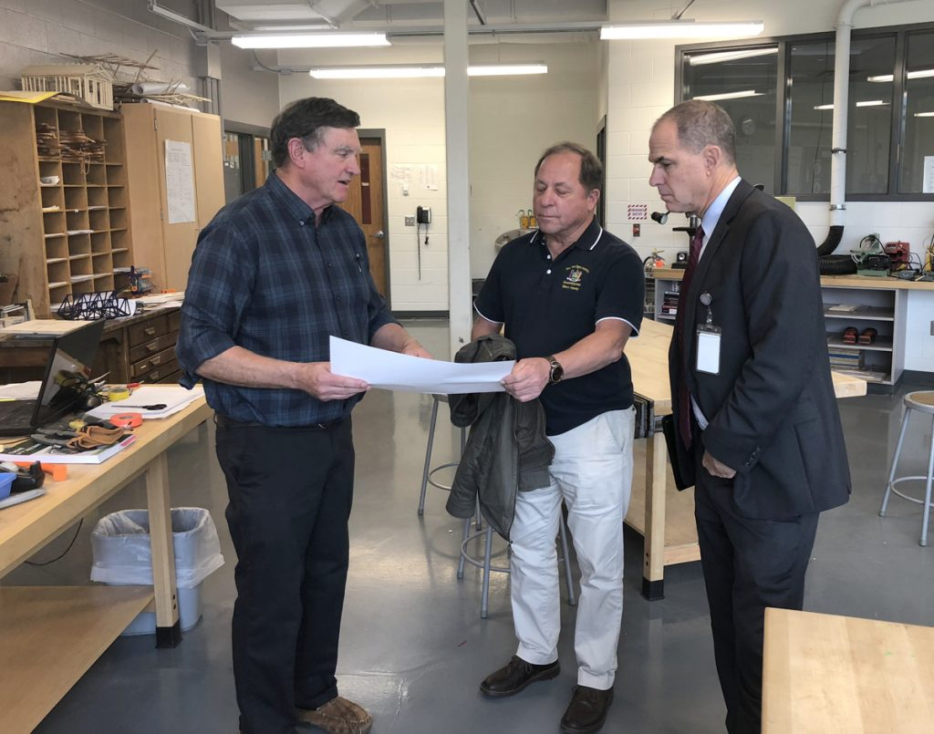 Hawley_tech –  From left, Technology teacher Tim Rogers shows Assemblyman Steve Hawley and Superintendent Brian Bartalo the blueprint for a project Rogers' Geometry in Construction class is working on.