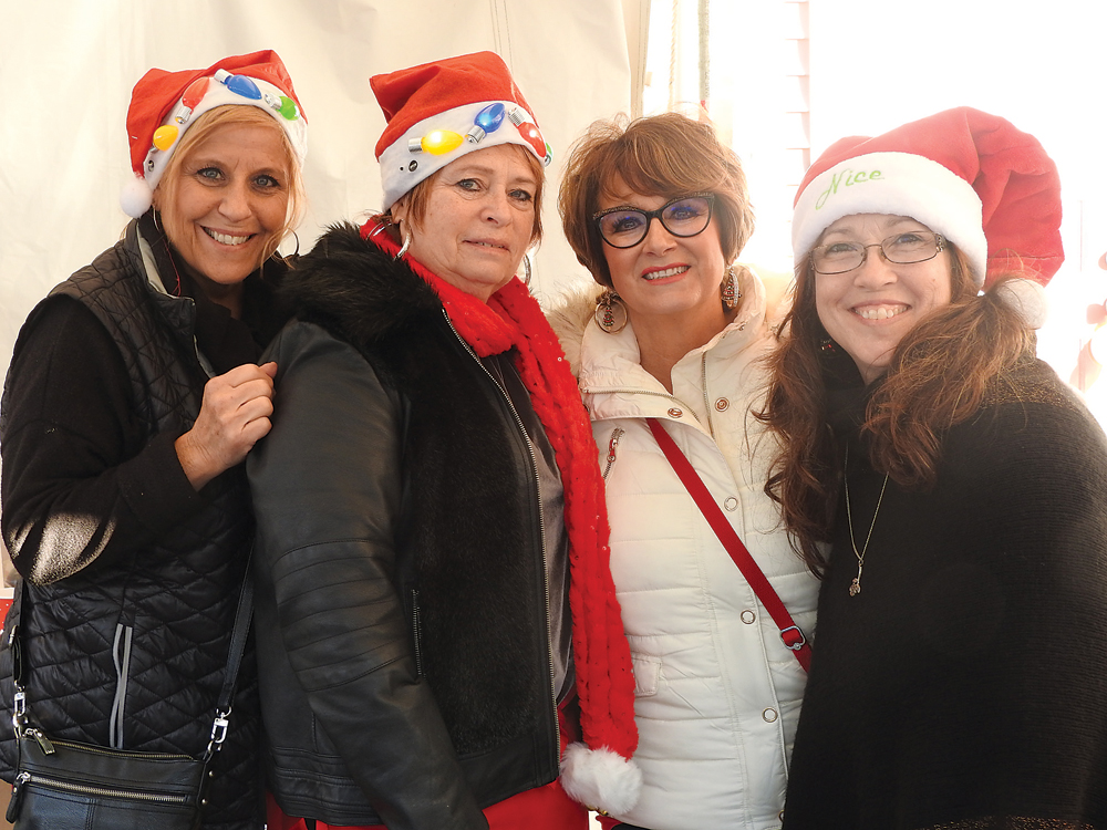 Dolly Guidice, Charlene Giambrone, Elaine Spaziano, founder chairperson for Christmas on the Cnal and Cathy Holding volunteering for the day.