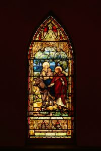 Mary Jane and Daniel Holmes commissioned the stained-glass window Flight Into Egypt, which was crafted in antique glass and painted in England circa 1890. It is one of 14 stained glass windows which tell the story of the life of Jesus and include five windows created by Louis Comfort Tiffany.