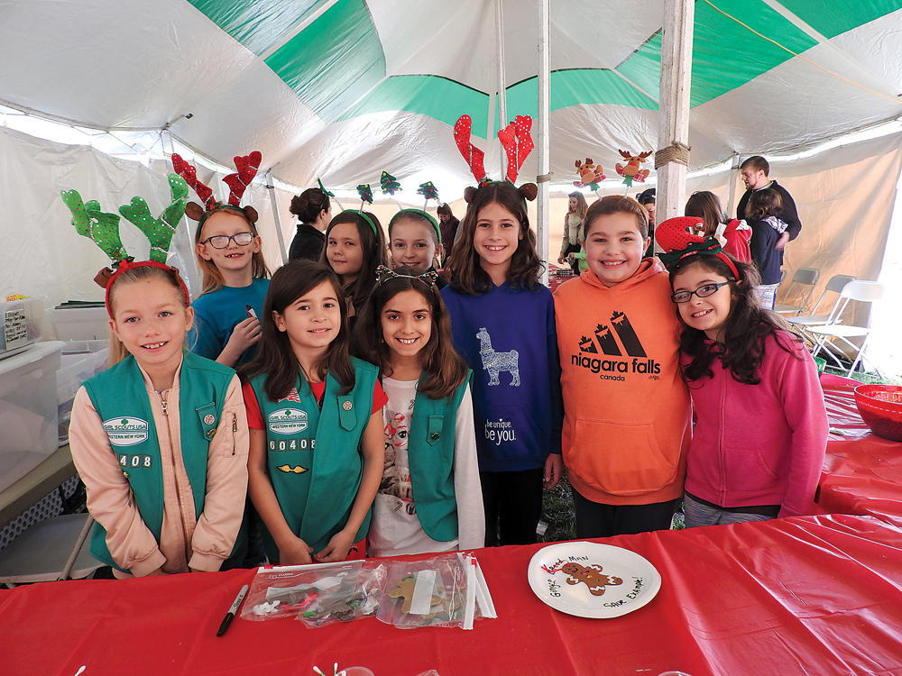 Girl Scout Troop 60408 from Spencerport helped int eh Children's Craft Tent at Christmas on the Canal.