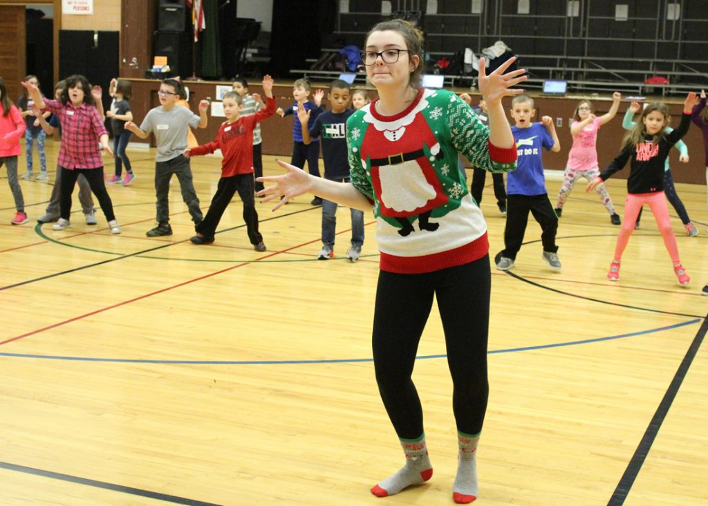 Jasmine Wood teaches CES second-graders a holiday dance routine.