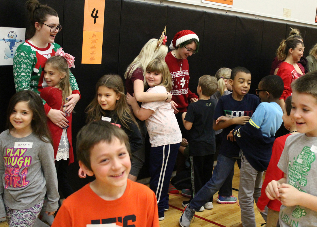 """CES students showed their appreciation to the """"big kids"""" for the wonderful dance experience with smiles and hugs."""