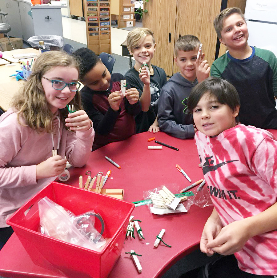 (L-R) Kate Kosiorek, Dominic Hall, Jackson Simmons, Jameson Grape, Evan John and Sofia Beghini make crafts for the Quest Elementary Joy Shop, which raised $3,201 for children in need locally and globally.