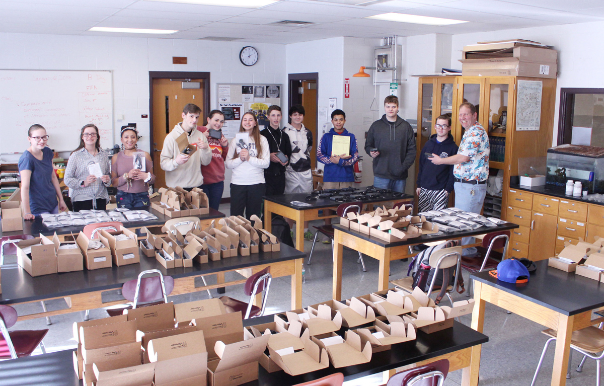 Byron-Bergen students assist in unpacking the new equipment. Photo by Gretchen Spittler