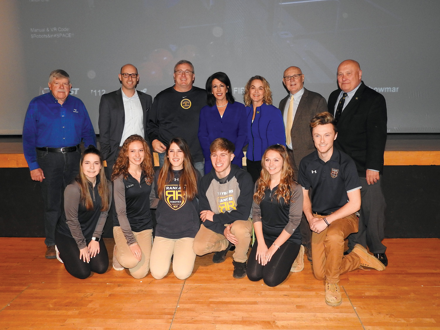 Local officials attended the kickoff to show their support of students participating in the FIRST® Robotics 2019 Challenge. Back row (l-r): Gary Penders (Spencerport Village Mayor), Mike Zale (County Legislator), Dan Milgate (Spencerport SCSD Superintendent), Cheryl DiNolfo (County Executive), Traci DiFlorio (County Legislator) Frank Alkoffer (County Legislator), George Hebert (County Legislator). Front row (l-r): Spencerport students Abby Case, Leigha Bopp, Tori Warner, Justin Hockenberger, Alyssa Epping, Sean Bracken (President of Team 3015 Ranger Robotics).