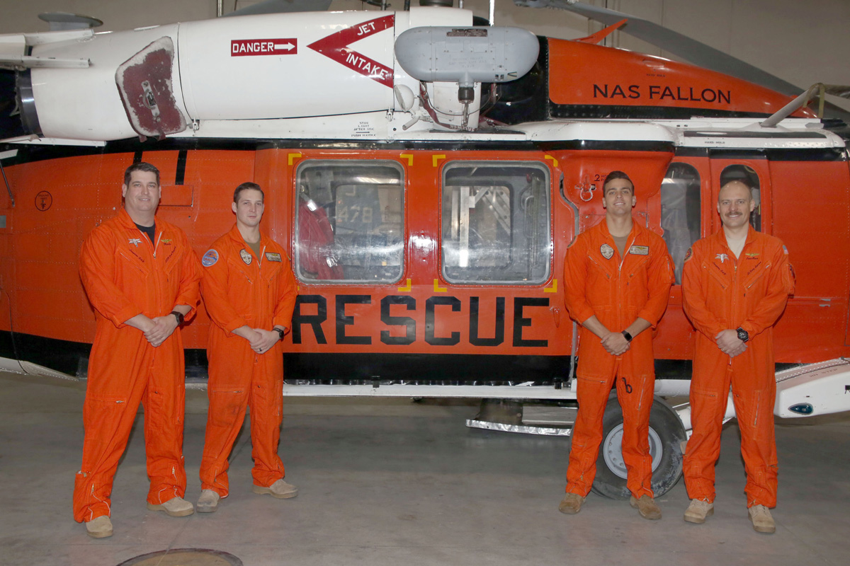 The Longhorns Search and Rescue team from Naval Air Station Fallon that conducted a rescue in the Sierra Mountains southeast of Lake Tahoe on January 7 stand by one of their three MH-60S Knighthawk helicopters. The crew that participated in the rescue are, from left to right, Lieutenant Commander Joshua Haggard, crew chief Naval Aircrewman Helicopter 2nd Class Jacob Glende of Spencerport, Naval Aircrewman Helicopter 2nd Class Michael Dragan-Gosselin and mission commander Lieutenant Cary Lawson. Provided photo