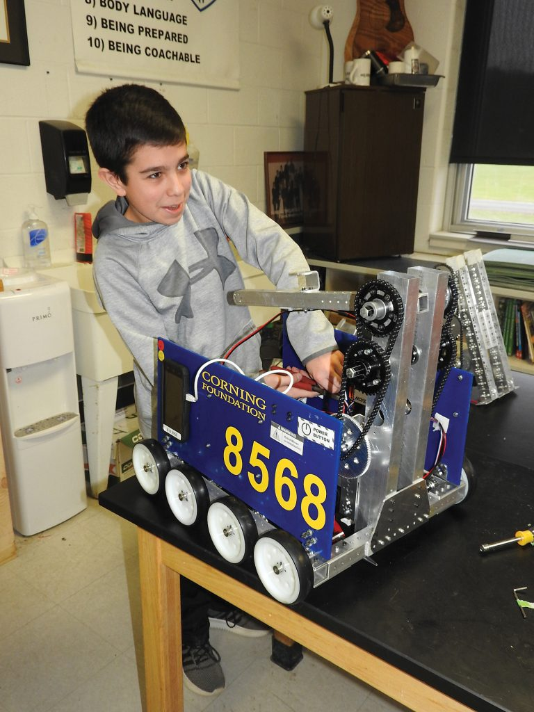 Sal Pino, a student on the Spencerport FRC team who was preparing for one of their regional competitions at Corning High School.