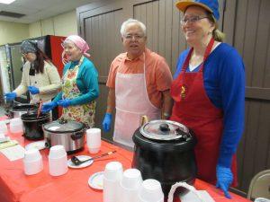 "Volunteers (l-r):  Jennifer Sheldon, Barb Grady, Sal Sciremammano, and Karen Keck ready to serve ""tasters."""