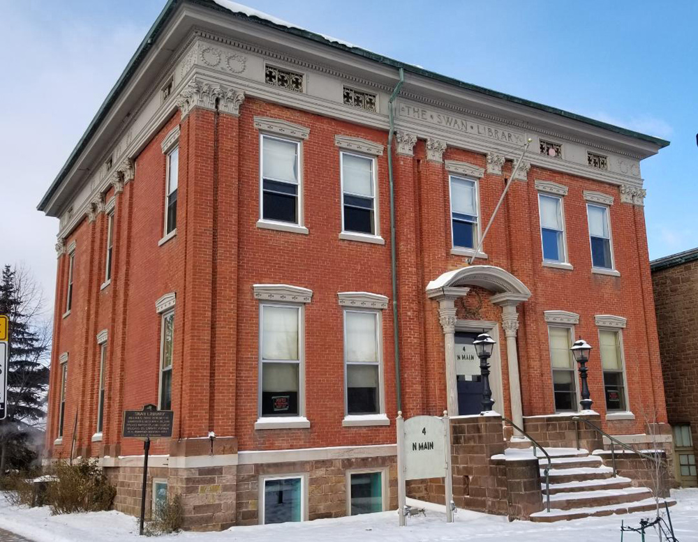 This is the former Swan Library, a stately Greek Revival building on Main Street in Albion. Chad Fabry recently purchased it for his school named Inspector Central. Photo by Dianne Hickerson