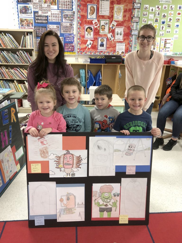 """Eclectic Arts and elementary students pose with """"Monster Mash"""" projects. Photo by Sandy Auer"""