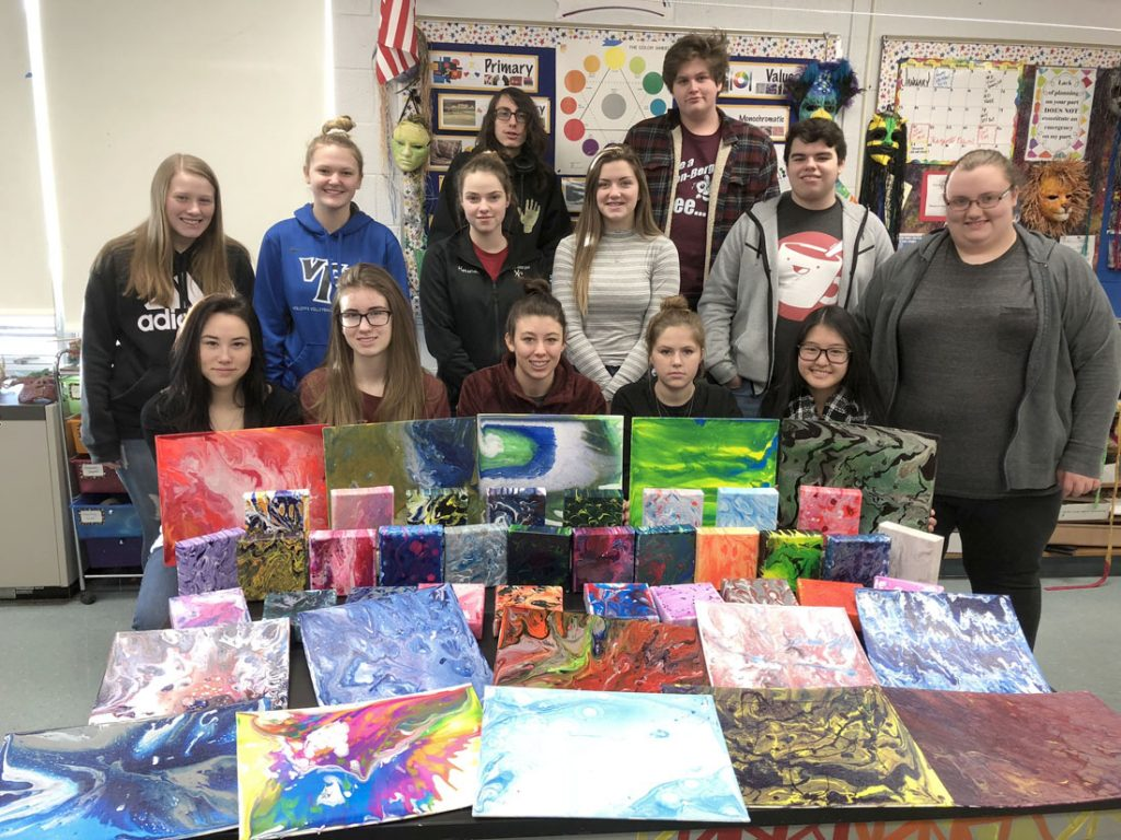 Eclectic Arts class with acrylic pour paintings. Photo by Sandy Auer