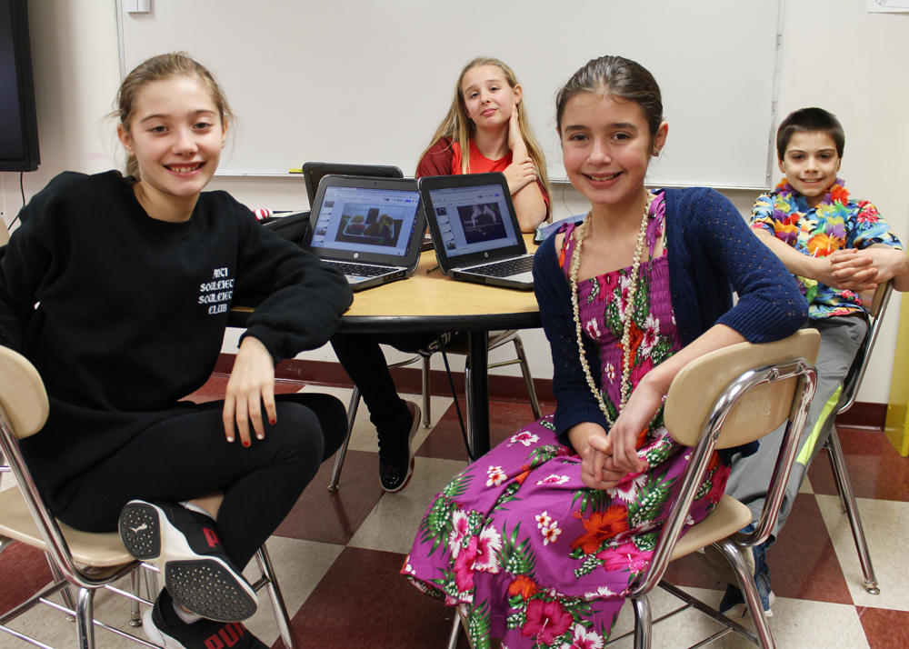 Sixth-graders (l-r) Makayla Hazard, Phoenix Pape, Sophie Wanck-Kann and Billy Morgan get together at lunchtime every week to work on their plans for expanding recycling in their cafeteria. Not pictured: team member Ava Donaghue.