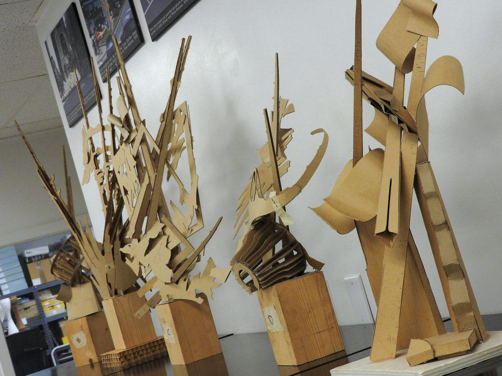 Cardboard models of sculptures.