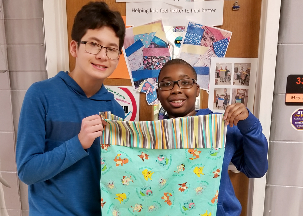 Tyler Nguyen and Olufemi Akinpelu display their dynamically-patterned pillowcase.