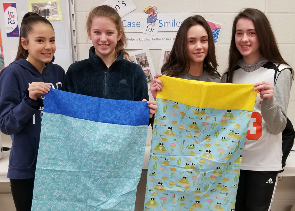 FACS students (l-r) Alyssa Benedetto, Laura Bunk, Madison Hauck and Julia Lennon with their cheerful pillowcases.