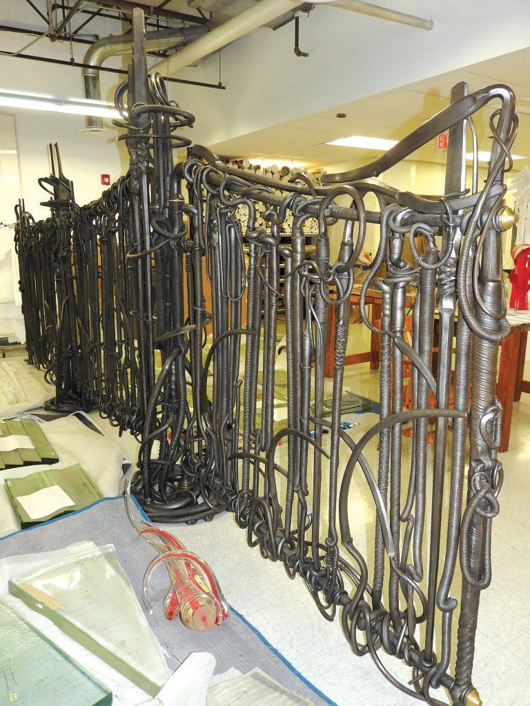 Metal gate on display in gallery.