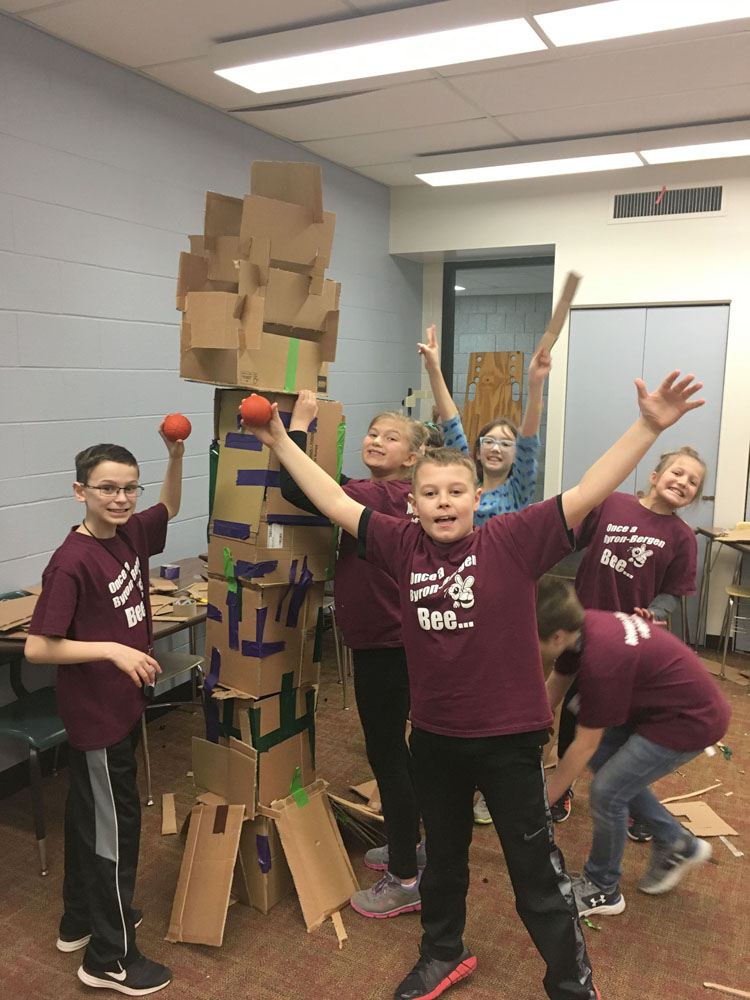 Byron-Bergen STEAM Jam team completing their basketball tower. Photo by Diane Taylor