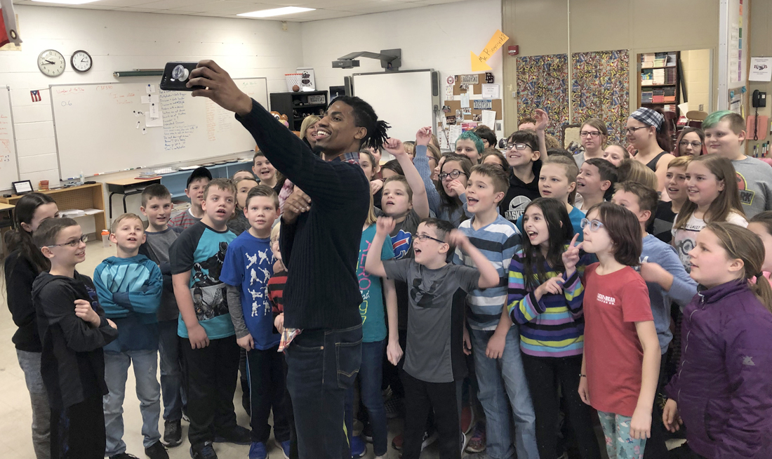 Marcus Bowen with Byron-Bergen students. Photo by Gretchen Spittler