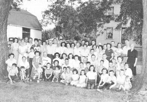 A Wittman family reunion circa 1949. Mary, then about five years old, is in the front row.