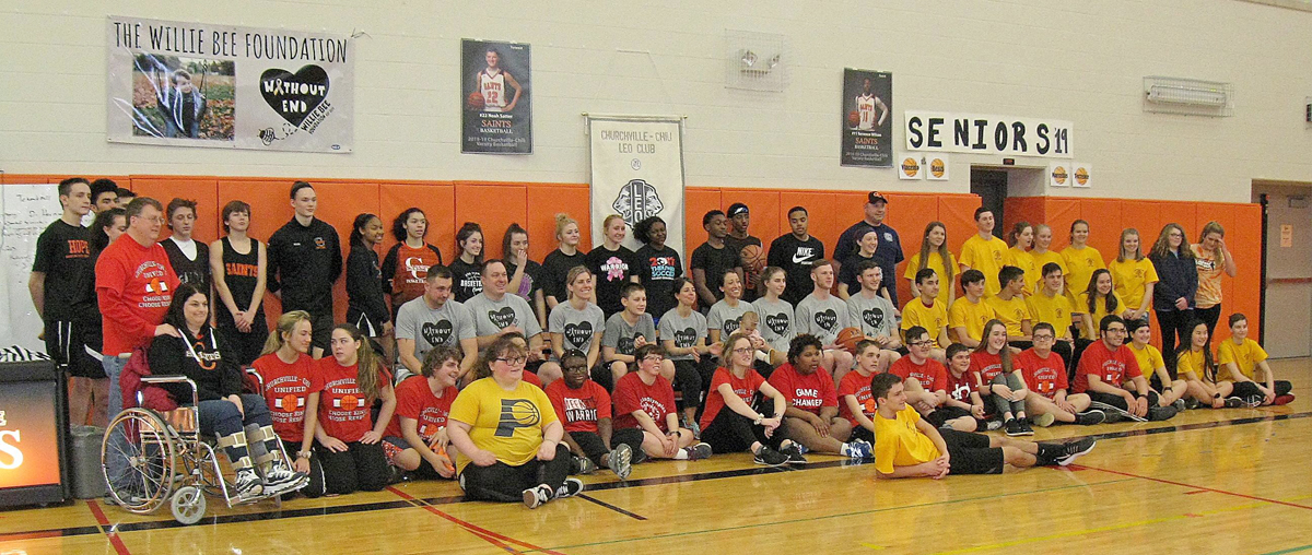 Participants in the March Mayhem benefit basketball game.