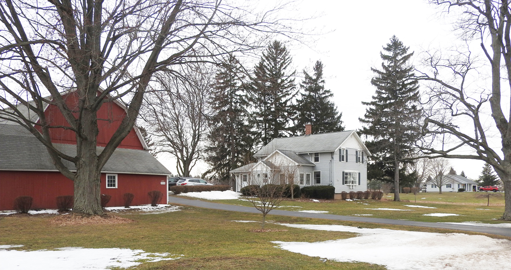 Shown is the original Wittman homestead on Ogden Center Road, Ogden. It is now the residence of Patricia (Wittman) Brown and her family. At the far right is the home of Mary (Wittman) Rupp. Also on the family farm land, but not shown, is the home now occupied by Mary Rupp's daughter and her family. Photo by Karen Fien.