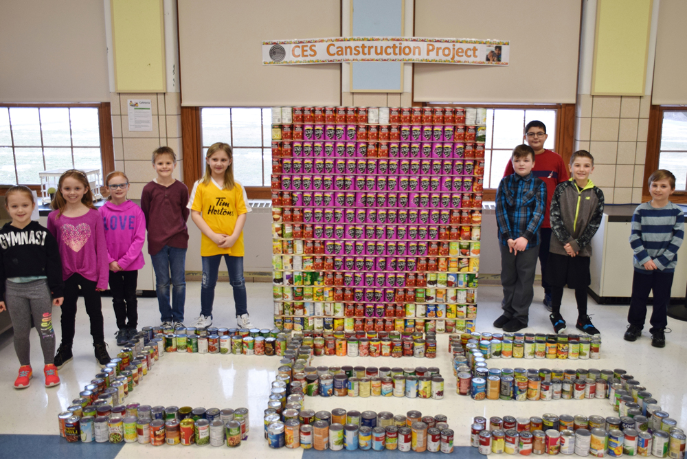 Churchville Elementary School completed a 1,000+ can Canstruction project in March with all donated food going to Foodlink. Third-grader Grace Hasselberg (left) led the project.