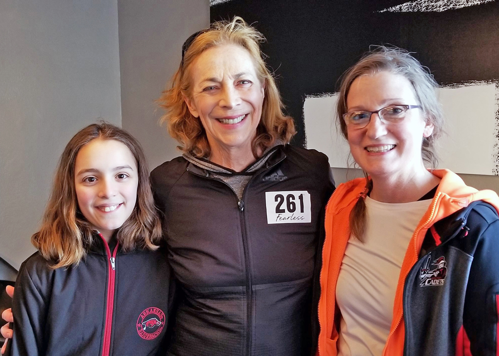 Cassidy Rose Seifert-Smith, a fourth grader at Quest Elementary School in Hilton, and Theresa Jason, (right) a business teacher at Hilton High School, meet Kathrine Switzer, the first woman to run the Boston Marathon. Provided photo