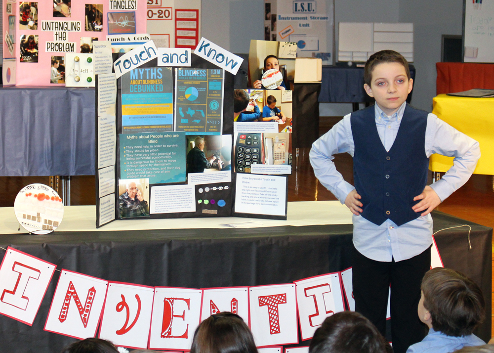 Camryn Frisbee, a fifth grader at Northwood Elementary School, presents his invention to help blind and visually impaired people identify items and become more independent