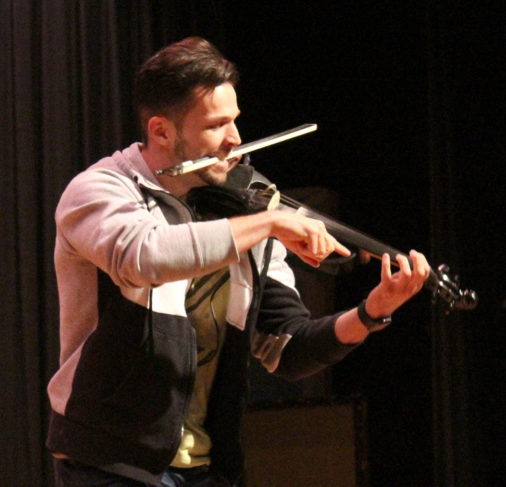Svet performs for Byron-Bergen students and staff.