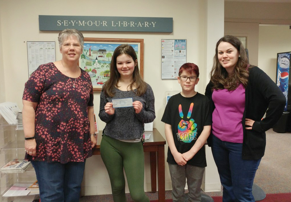 Pictured (left to right): Robin Donahue, Teen Closet Coordinator; Victoria Loveridge, Seymour Library's TLC President; Joshua Sauers, BRATS President; and Stephanie Blando, Teen Services Librarian Trainee.