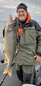 Jody Button of Fairport with a beautiful Lake Erie ... lake trout.