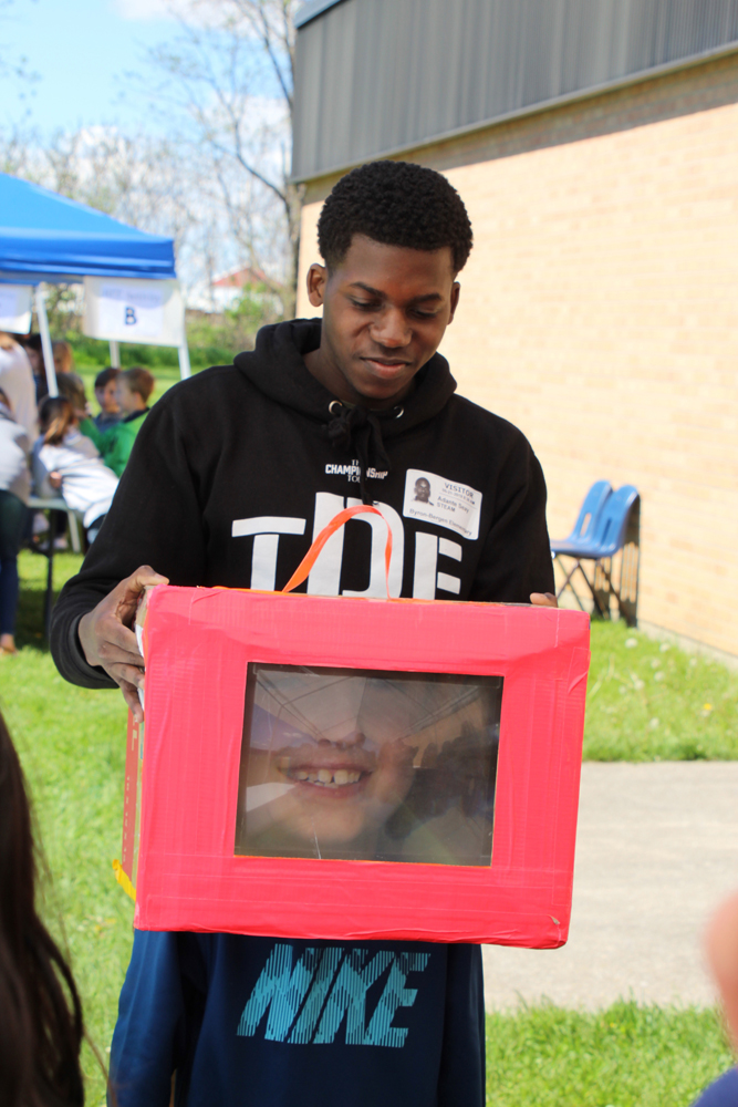 "RIT student demonstrates ""Big Head Box."""