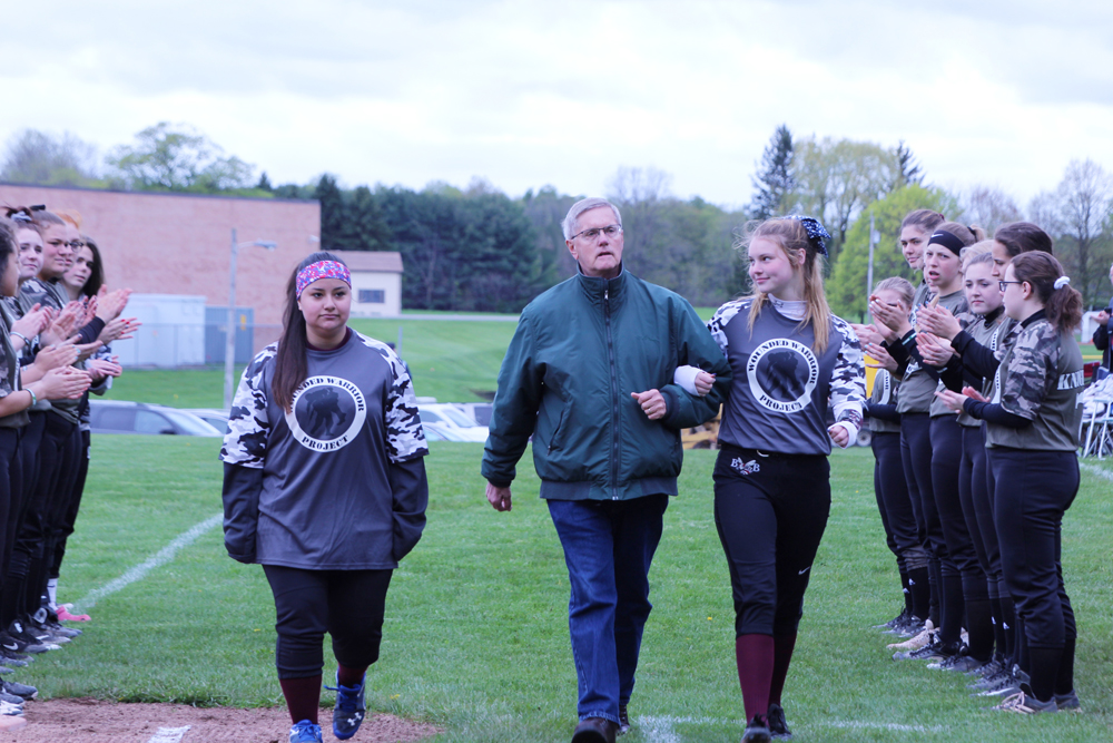 Vietnam Veteran Fred Bauer Jr., escorted by his granddaughter Chloe and fellow teammate Lucy. Photo by Gretchen Spittler