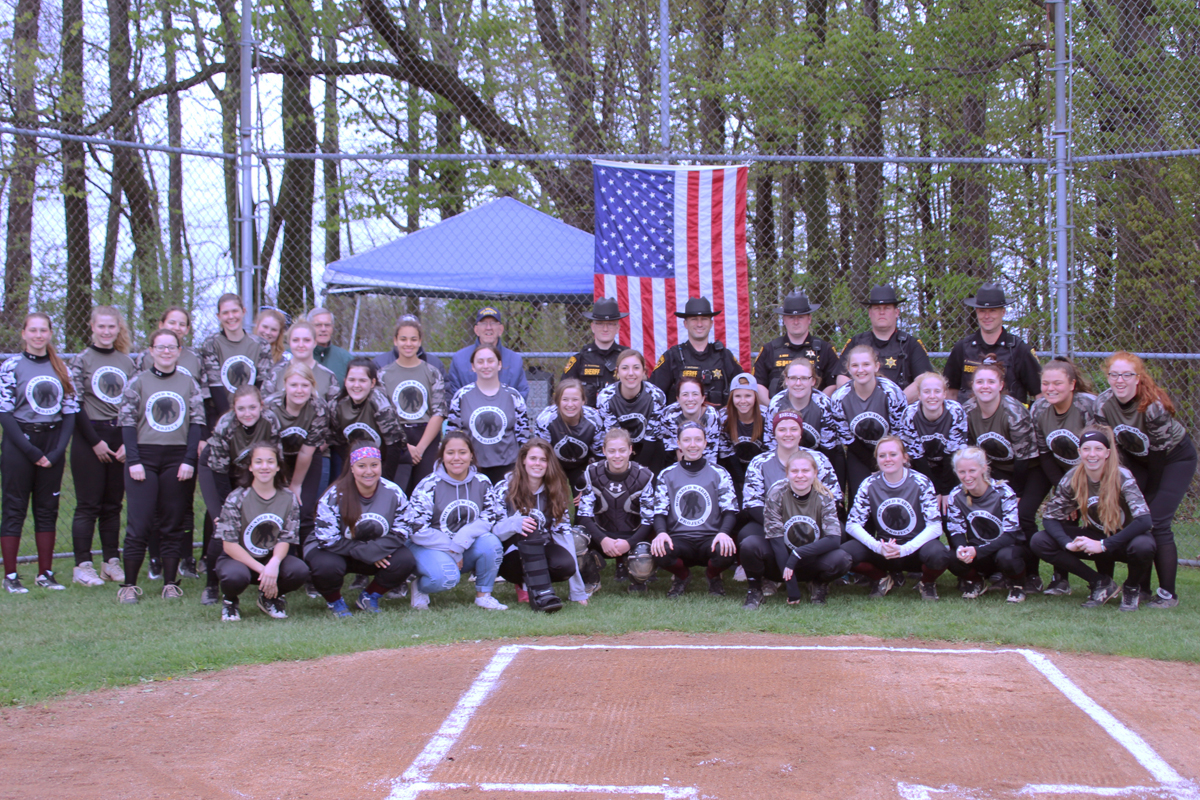 The Byron-Bergen Varsity Softball team, York Varsity Softball team, and local veterans who participated in the ceremony. Photo by Gretchen Spittler