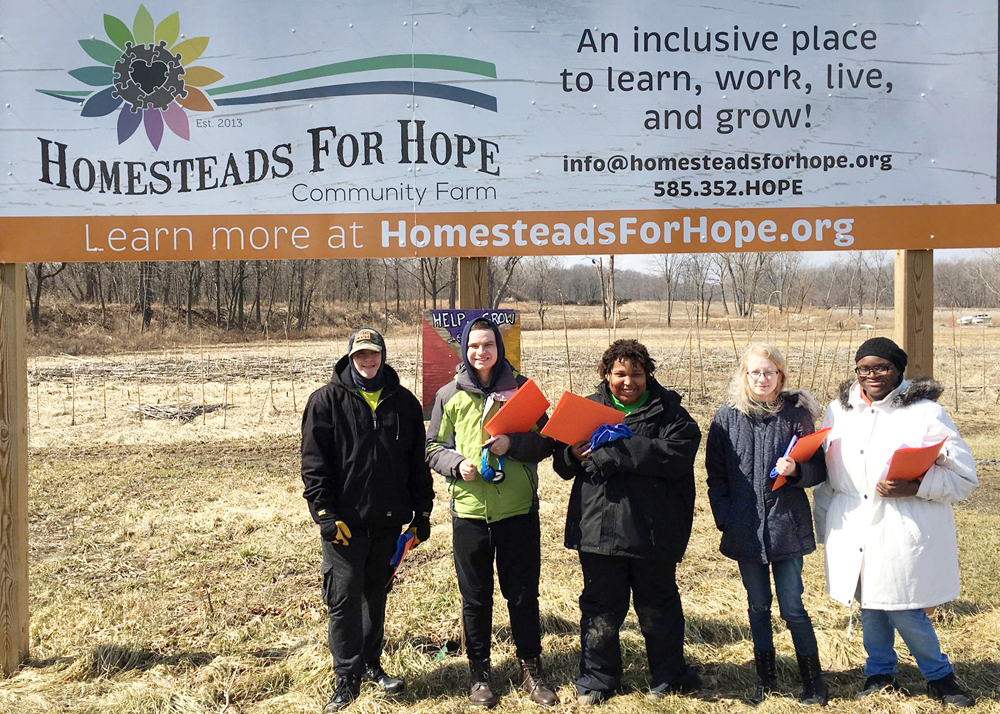 Churchville-Chili Life Skills students visiting Homesteads for Hope, the organization they chose to support this year with the proceeds from their annual crafts project.