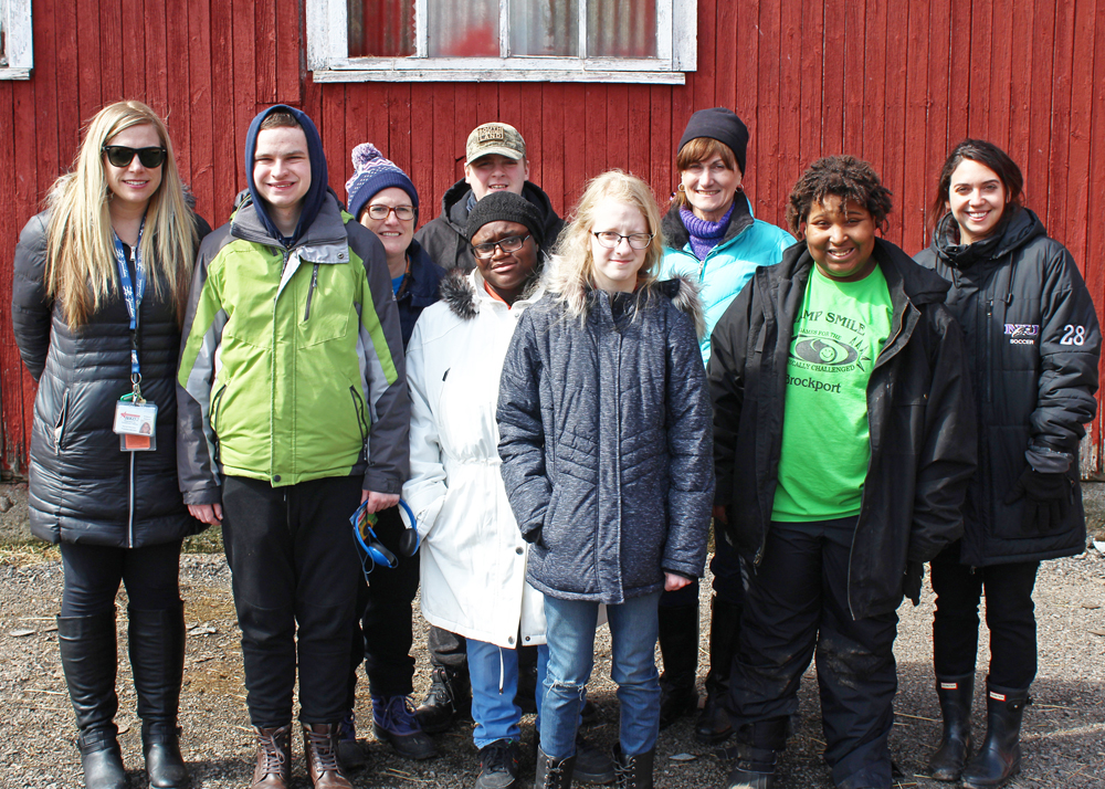 The five Life Skills students with Transition Specialist Kim Spagnola, teacher Margaret Brongo, TA Laurie Kalwas and student teacher Andrea Visca stand outside a barn at Homesteads for Hope.