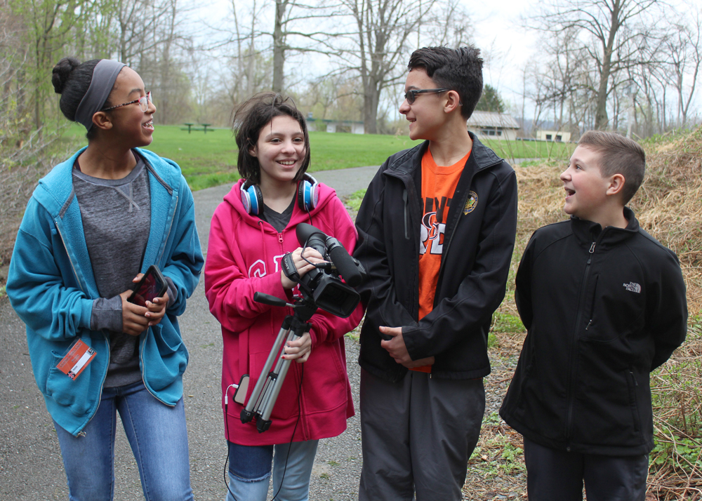 Four members of the school's video club were on hand to capture the event to share with the rest of the school. (l-r) Sarah Bracey, Kayla Monett, Mike DeBona, and Josh Bennigsohn.